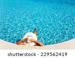 Lady With White Hat Laying In...