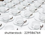 White Coffee Cups On A White...