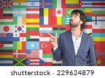 businessman thinking over flags ... | Shutterstock . vector #229624879