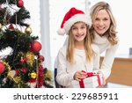 festive mother and daughter... | Shutterstock . vector #229685911