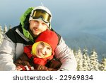 Couple in winter mountain - stock photo