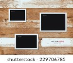 photo frame on vintage wooden...   Shutterstock .eps vector #229706785