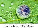 planet earth inside a raindrop... | Shutterstock . vector #229758565