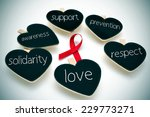 Small photo of a red ribbon for the fight against AIDS and some heart-shaped blackboards with words such support, prevention, respect, love, solidarity and awareness