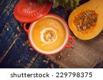Pumpkin Soup On Wooden...