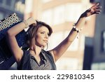 happy young fashion woman with... | Shutterstock . vector #229810345
