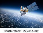 space satellite orbiting the... | Shutterstock . vector #229816309