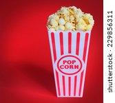 popcorn in box over red... | Shutterstock . vector #229856311