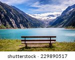 Wooden Bench At A Reservoir In...