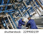 oil and gas workers with giant... | Shutterstock . vector #229900159