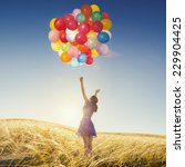girl with balloons in nature.... | Shutterstock . vector #229904425