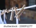 Stock photo clothes pins with white bags 230091277