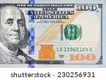 Small photo of Macro shot of a new 100 dollar bill