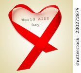 Small photo of a red ribbon forming a heart and the text world AIDS day on a beige background