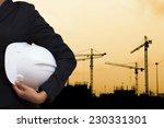 engineer holding white helmet... | Shutterstock . vector #230331301
