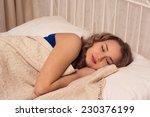 beautiful blonde sleeping on... | Shutterstock . vector #230376199