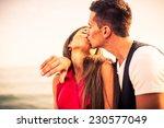 beautiful couple at sunset.   Shutterstock . vector #230577049