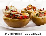 Baked Potatoes Stuffed With...