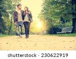 Couple Walking Hand In Hand In...