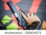 black pistol in a hand | Shutterstock . vector #230634271