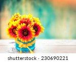 Fresh Flowers In Vase On Woode...