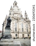 Small photo of DRESDEN, GERMANY - JUNE, 26th, 2014: Frauenkirche (Church of Virgine Mary) one of most famous landmark of Dresden with Martin Lither monument in front on 26th June 2013. Grunge effect