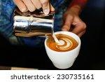 hand of barista making latte or ... | Shutterstock . vector #230735161