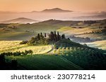 Tuscany, farmhouse in the country, blue sky, green grass, italian landscape