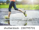 Young Woman Running On Asphalt...