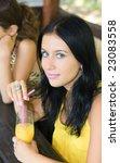 lovely girl drink juice in cafe | Shutterstock . vector #23083558