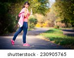 a girl drinks water after sport | Shutterstock . vector #230905765
