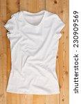 white t shirt on a wooden... | Shutterstock . vector #230909569