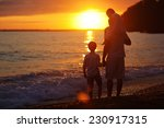 silhouettes of a happy family ... | Shutterstock . vector #230917315