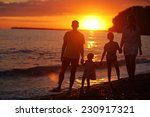 silhouettes of a happy family ... | Shutterstock . vector #230917321