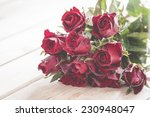 Stock photo red rose on wooden table 230948047
