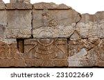 Small photo of Ahura Mazda - persian bas-relief in Persepolis, Iran. Ancient Persian art, sculpture in Iran. Zoroastrian persian art.