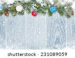 christmas wooden background...   Shutterstock . vector #231089059