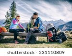 man and woman hikers hiking and ... | Shutterstock . vector #231110809