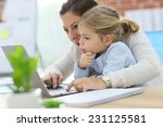 mother working at home office... | Shutterstock . vector #231125581