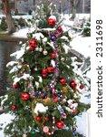 decorated xmas tree outdoors - stock photo