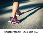 sporty woman running on road at ... | Shutterstock . vector #231185467