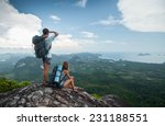 two hikers standing on top of... | Shutterstock . vector #231188551