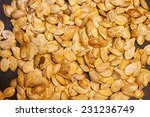 roasted pumpkin seeds  on a... | Shutterstock . vector #231236749