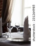 tables set for meal   Shutterstock . vector #231264985