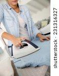 closeup of woman ironing... | Shutterstock . vector #231316327