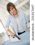 young home service woman... | Shutterstock . vector #231317647