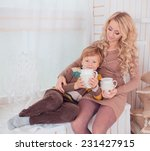 portrait of happy mother and... | Shutterstock . vector #231427915