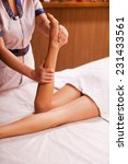 massaging legs. top view of... | Shutterstock . vector #231433561