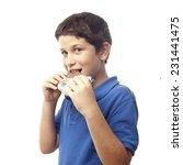 closeup of boy eating chocolate ...   Shutterstock . vector #231441475