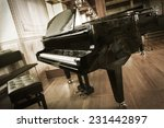 Grand Piano With A Chair In The ...